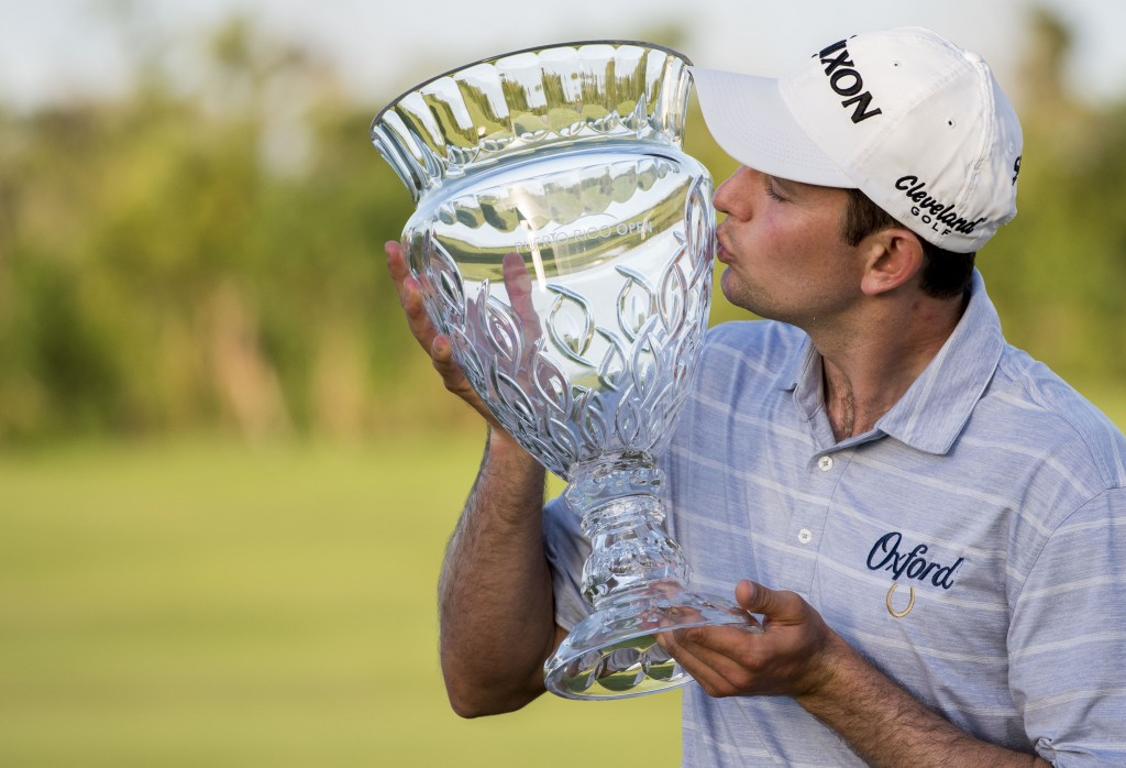 Martin Trainer of California kisses the championship cup after winning the Puerto Rico Open PGA golf tournament in Rio Grande, Puerto Rico, Sunday, Fe...