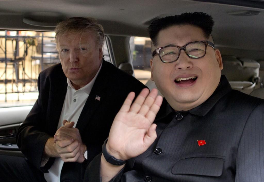 Howard X, right, an Australian impersonating North Korean leader Kim Jong Un, waves as Russel White, a U.S. President Donald Trump impersonator, gestu