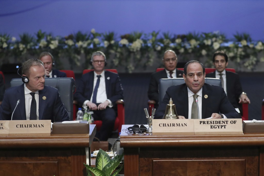 European Council President Donald Tusk, left, and Egypt's President Abdel-Fattah El-Sisi, right, attend a round table meeting at an EU-Arab summit at ...