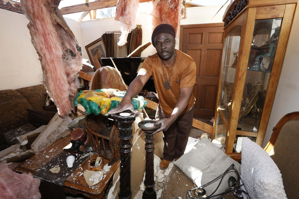 Charles Lowery of Columbus, Miss., rescues carved stands from the remains of his home, Sunday, Feb. 24, 2019, following Saturday's tornado. Lowery lam...