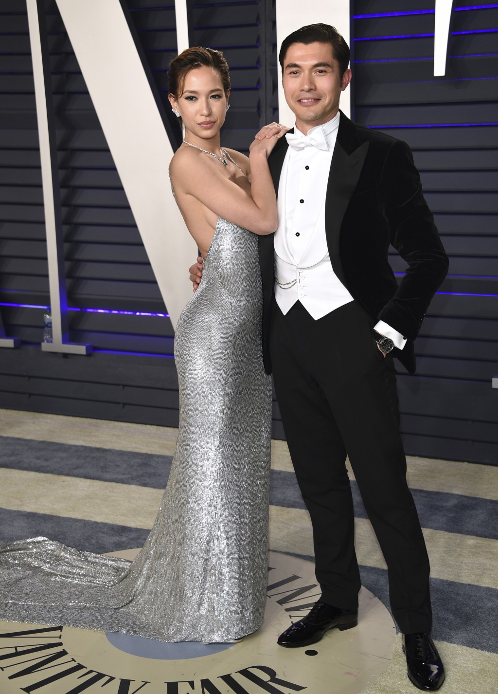 Henry Golding, right, and Liv Lo arrive at the Vanity Fair Oscar Party on Sunday, Feb. 24, 2019, in Beverly Hills, Calif. (Photo by Evan Agostini/Invi
