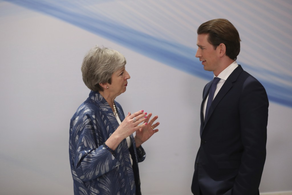 British Prime Minister Theresa May, left, speaks with Austrian Chancellor Sebastian Kurz prior to a group photo at an EU-Arab summit at the Sharm El S