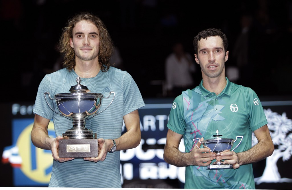 Stefanos Tsitsipas of Greece winner, left, and Mikhail Kukushkin of Kazakhstan hold their trophies after their final match at the Open 13 Provence ten...