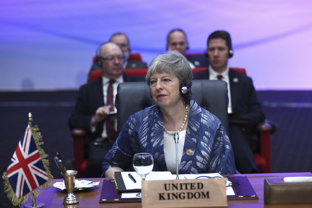 British Prime Minister Theresa May attends a meeting of leaders at an EU-Arab summit at the Sharm El Sheikh convention center in Sharm El Sheikh, Egyp...