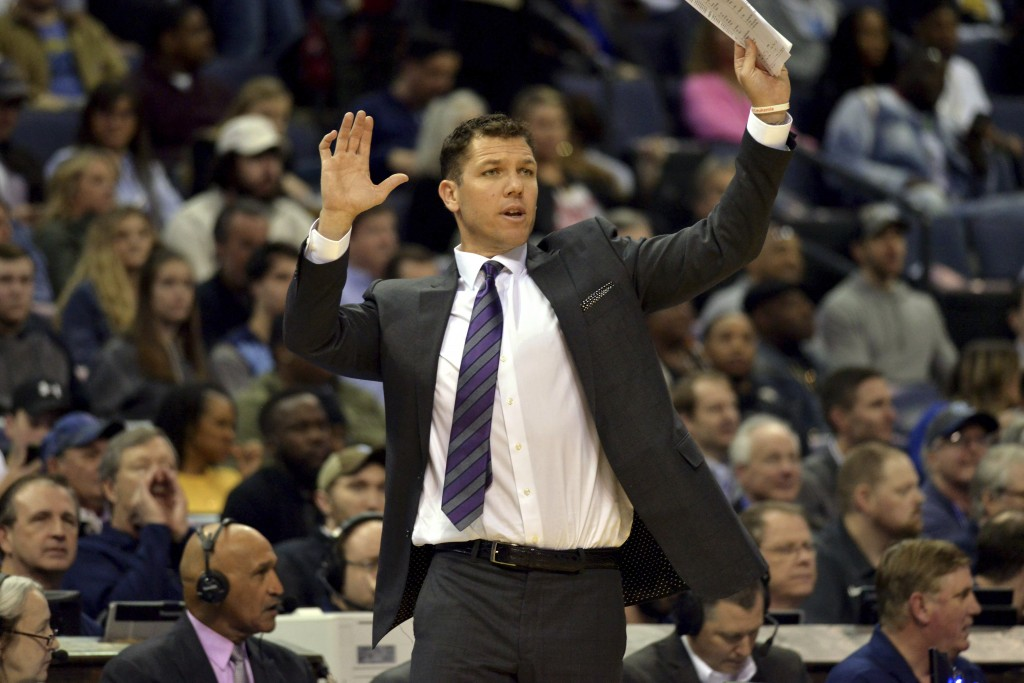 Los Angeles Lakers head coach Luke Walton gestures from the sideline in the first half of an NBA basketball game against the Memphis Grizzlies, Monday