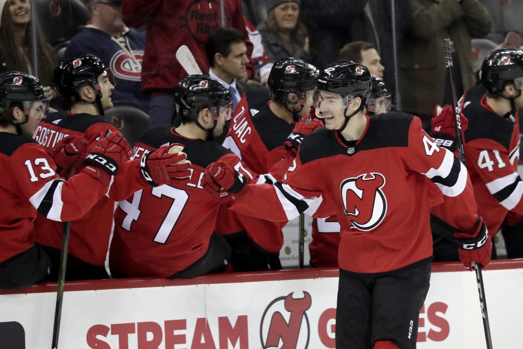 New Jersey Devils right wing Nathan Bastian (42) celebrates with teammates after scoring his first career goal during the first period of an NHL hocke...
