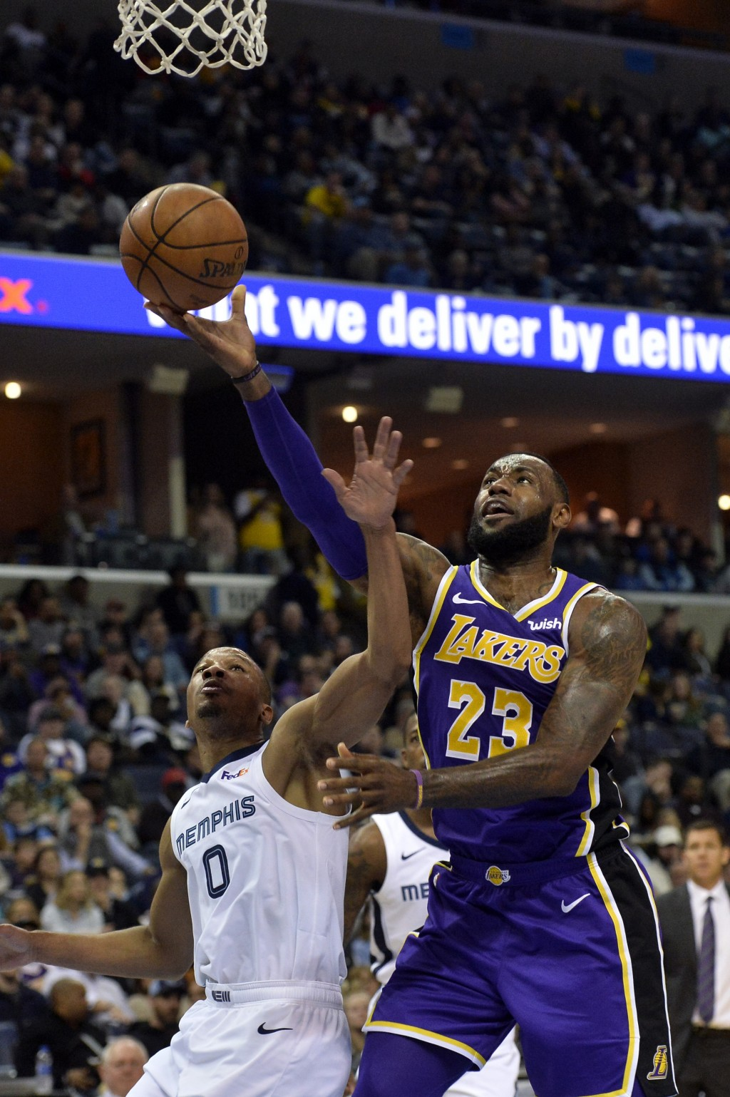 Los Angeles Lakers forward LeBron James (23) shoots against Memphis Grizzlies guard Avery Bradley (0) in the first half of an NBA basketball game Mond