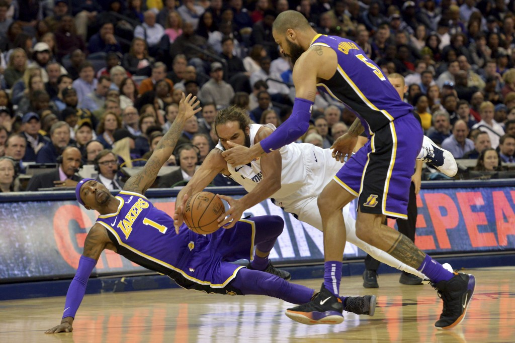 Los Angeles Lakers guard Kentavious Caldwell-Pope (1) and Memphis Grizzlies center Joakim Noah, center, fall to the court as they struggle for control...