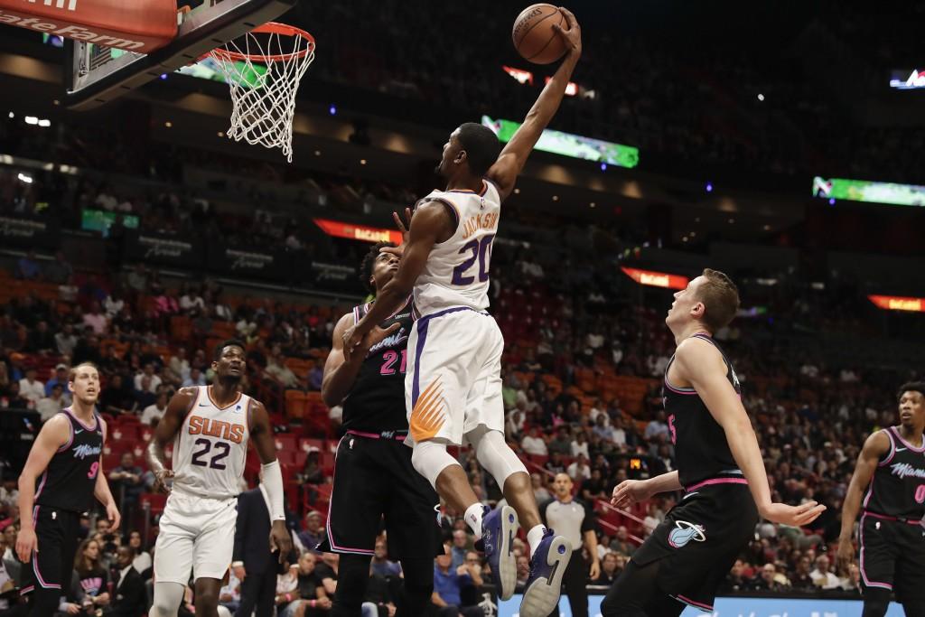 Phoenix Suns forward Josh Jackson (20) shoots against Miami Heat center Hassan Whiteside (21) during the first half of an NBA basketball game Monday,