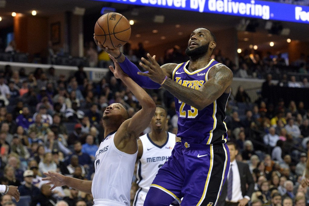 Los Angeles Lakers forward LeBron James (23) drives to the basket against Memphis Grizzlies guard Avery Bradley (0)in the first half of an NBA basketb...