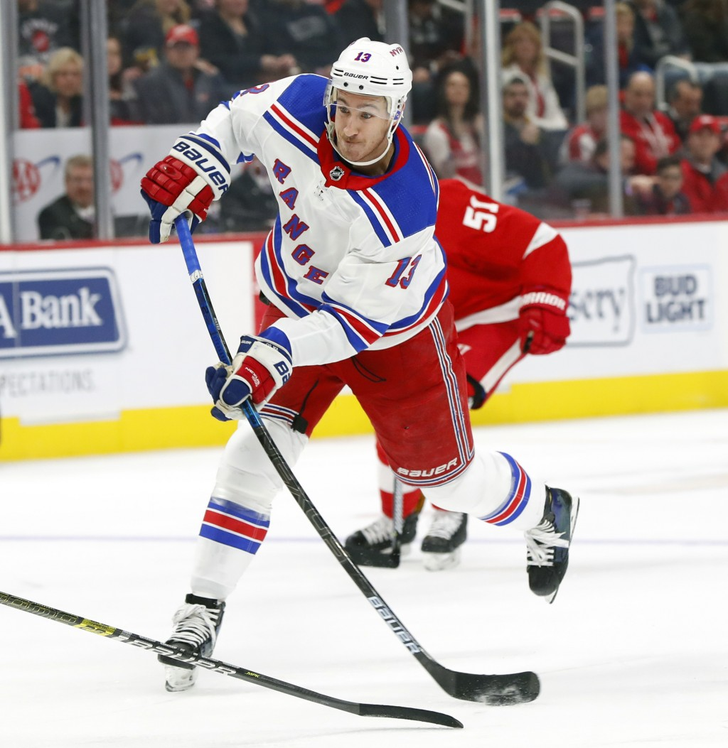 FILE - In this Nov. 9, 2018, file photo, New York Rangers center Kevin Hayes shoots against the Detroit Red Wings in an NHL hockey game, in Detroit. T...