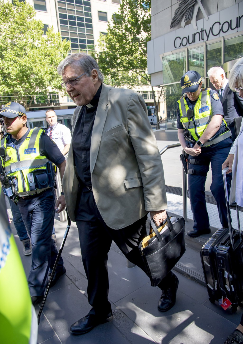 In this Friday, Feb. 22, 2019, photo, Cardinal George Pell leaves the County Court in Melbourne, Australia. The most senior Catholic cleric ever charg...