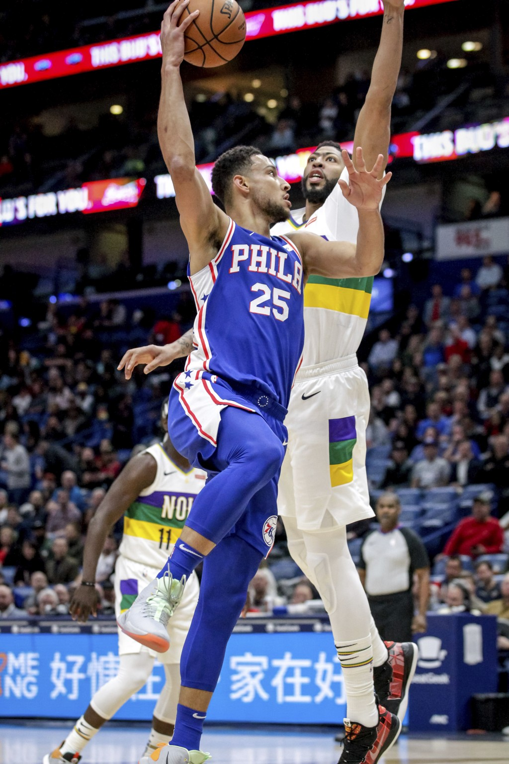 Philadelphia 76ers guard Ben Simmons (25) shoots against New Orleans Pelicans forward Anthony Davis (23) in the first half of an NBA basketball game i...
