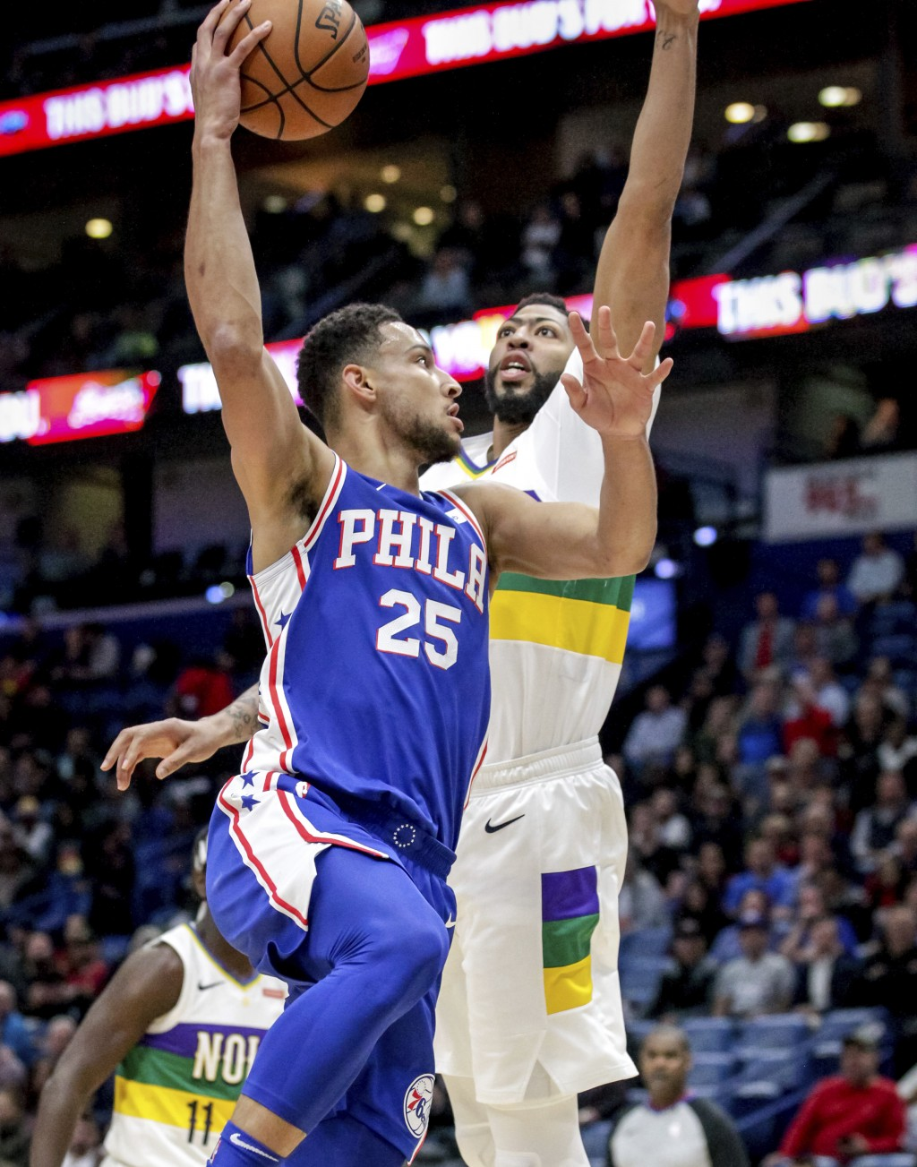 Philadelphia 76ers guard Ben Simmons (25) shoots against New Orleans Pelicans forward Anthony Davis (23) in the first half of an NBA basketball game i