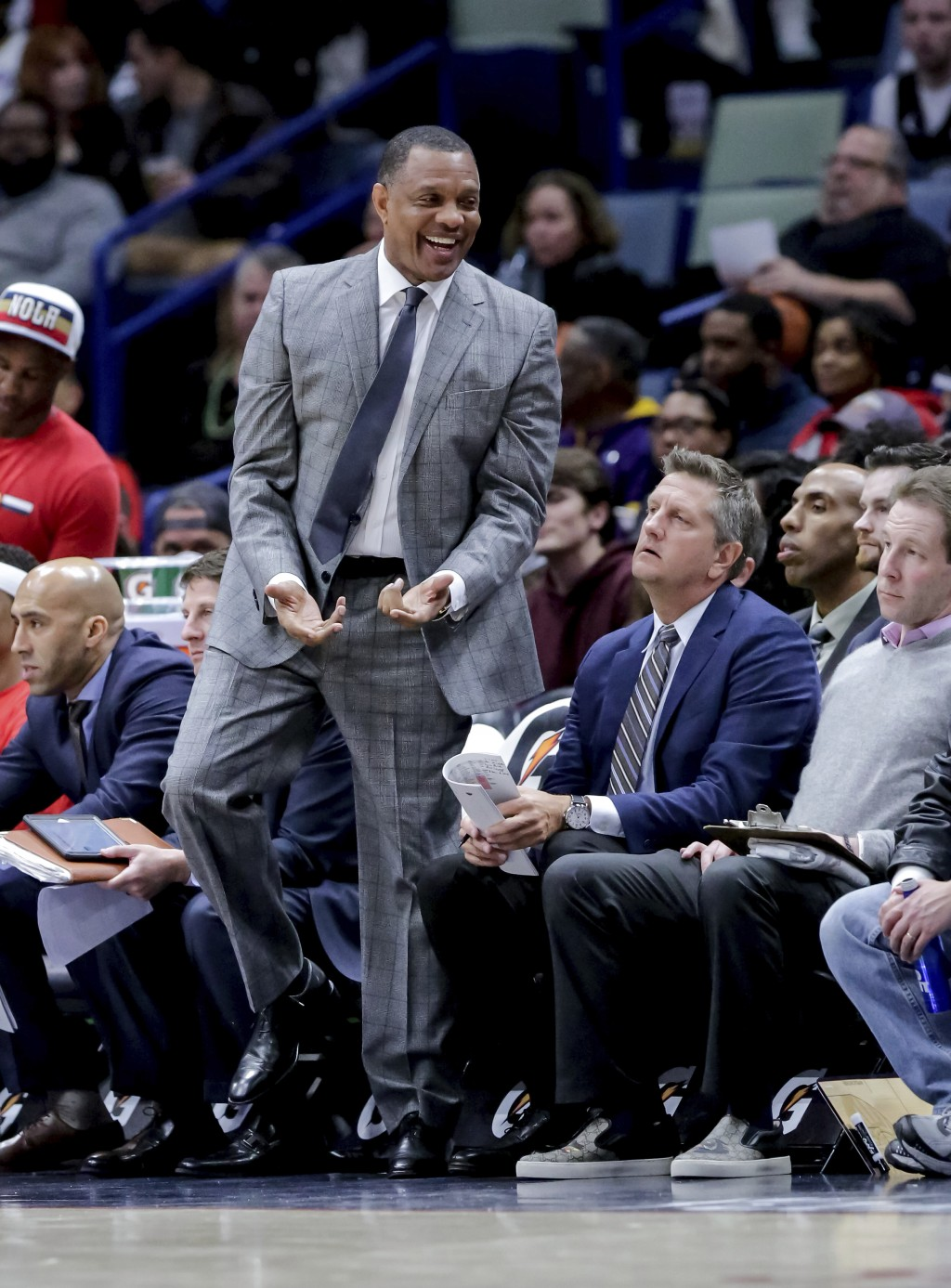 New Orleans Pelicans head coach Alvin Gentry reacts after a play against the Philadelphia 76ers in the first half of an NBA basketball game in New Orl...