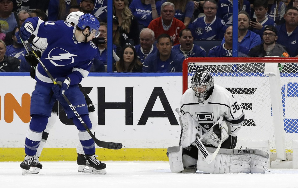 Tampa Bay Lightning center Anthony Cirelli (71) watches his deflection get past Los Angeles Kings goaltender Jack Campbell (36) for a goal during the ...