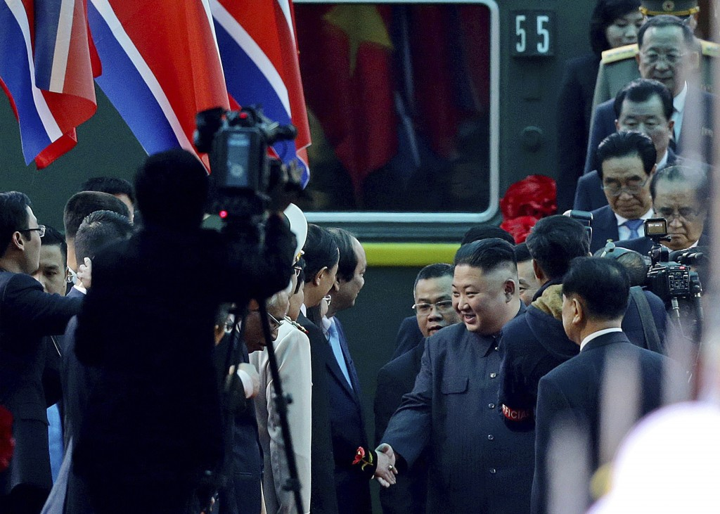 North Korean leader Kim Jong Un, center right, is welcomed upon arrival by train, back, in Dong Dang in Vietnamese border town Tuesday, Feb. 26, 2019,