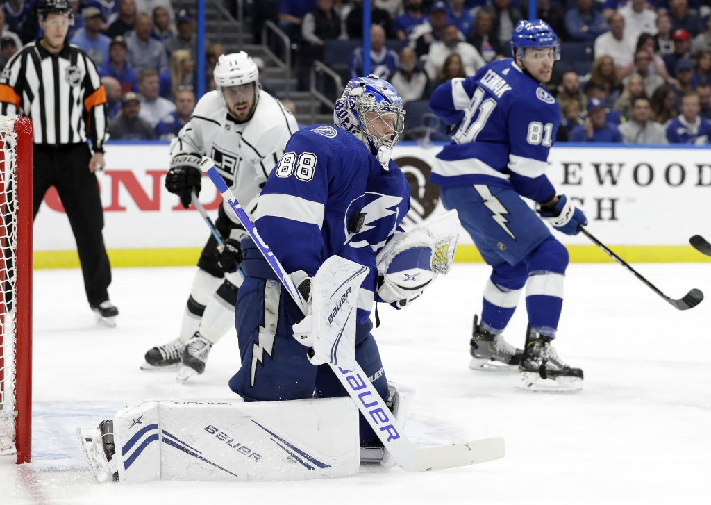 Tampa Bay Lightning goaltender Andrei Vasilevskiy (88) makes a save on a shot by the Los Angeles Kings during the first period of an NHL hockey game M...