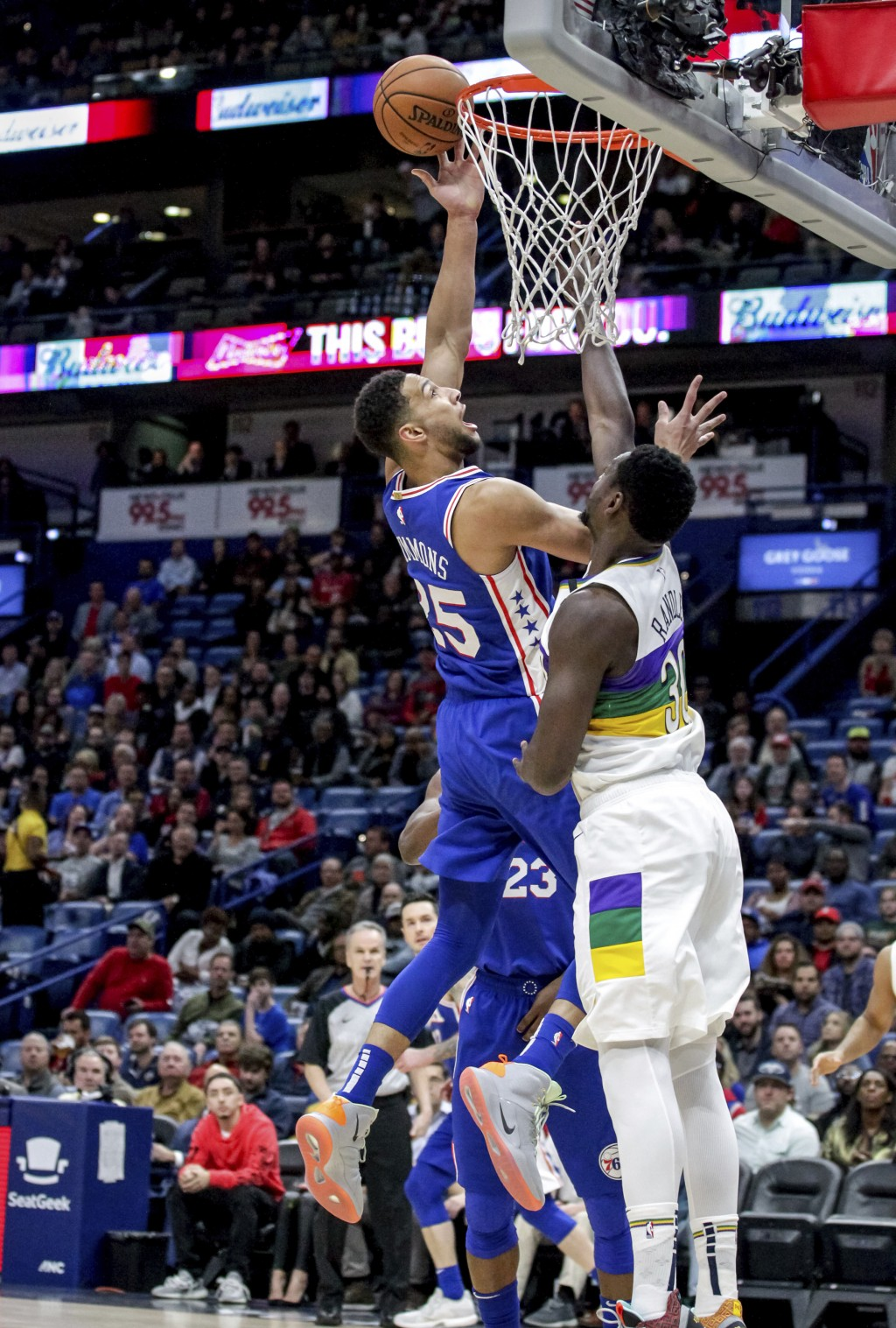 Philadelphia 76ers guard Ben Simmons (25) shoots over New Orleans Pelicans center Julius Randle (30) in the first half of an NBA basketball game in Ne...
