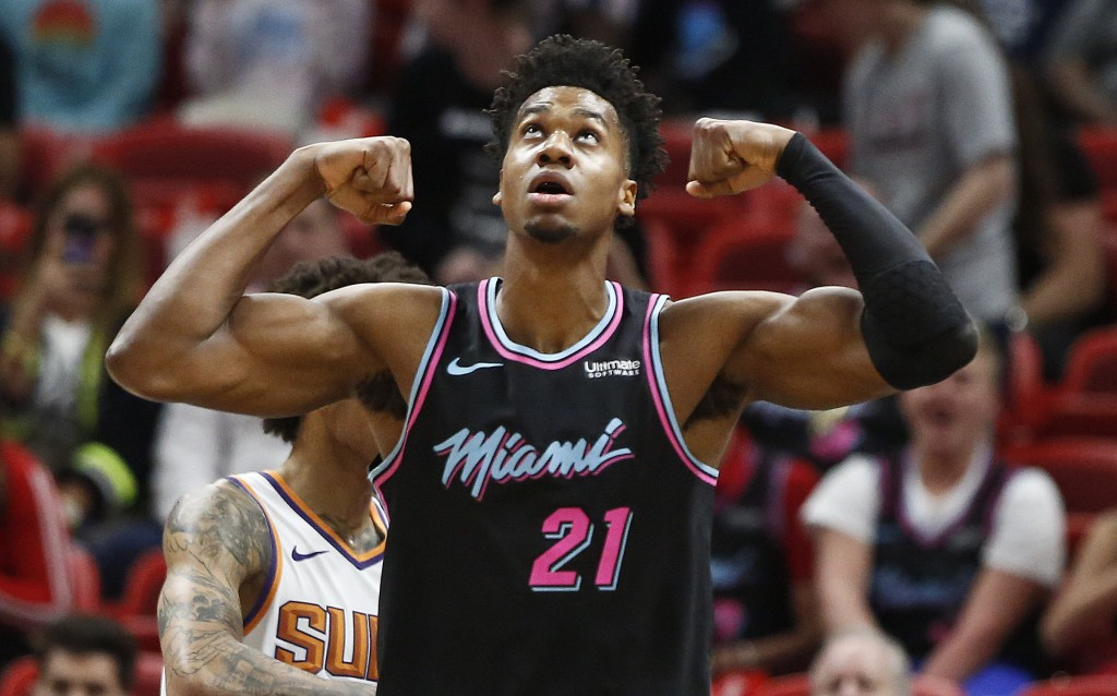Miami Heat center Hassan Whiteside (21) celebrates after scoring during the first half of an NBA basketball game against the Phoenix Suns on Monday, F...