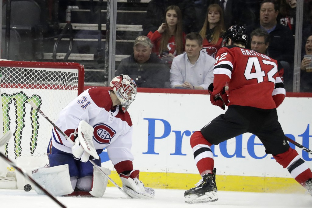 New Jersey Devils right wing Nathan Bastian (42) scores his first career goal against Montreal Canadiens goaltender Carey Price (31) during the first ...