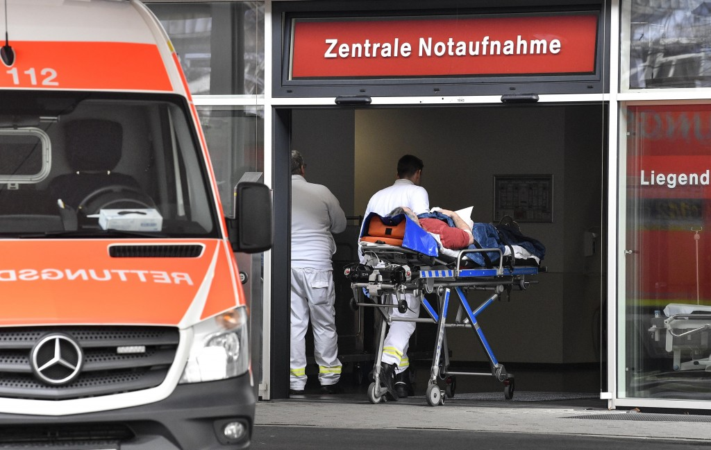 In this Tuesday, Feb. 12, 2019 photo, a patient is taken to the emergency room of the University Medical Center in Duesseldorf. The German hospital pl