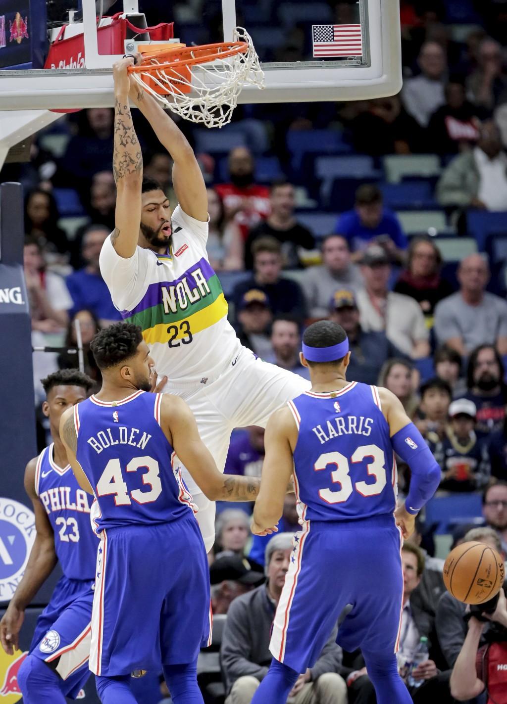 New Orleans Pelicans forward Anthony Davis (23) dunks as Philadelphia 76ers forward Jonah Bolden (43) and Philadelphia 76ers forward Tobias Harris (33...
