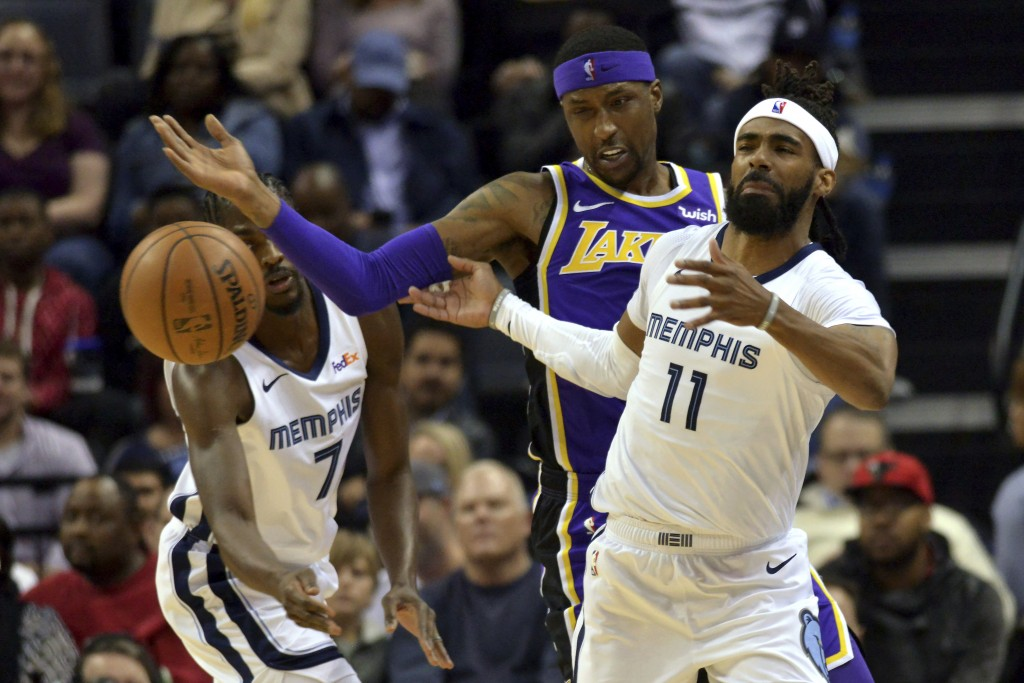 Memphis Grizzlies guard Mike Conley (11), Los Angeles Lakers guard Kentavious Caldwell-Pope, center, and Grizzlies forward Justin Holiday (7) struggle...