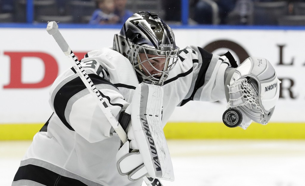 Los Angeles Kings goaltender Jack Campbell (36) can't hang onto a shot by the Tampa Bay Lightning during the second period of an NHL hockey game Monda...