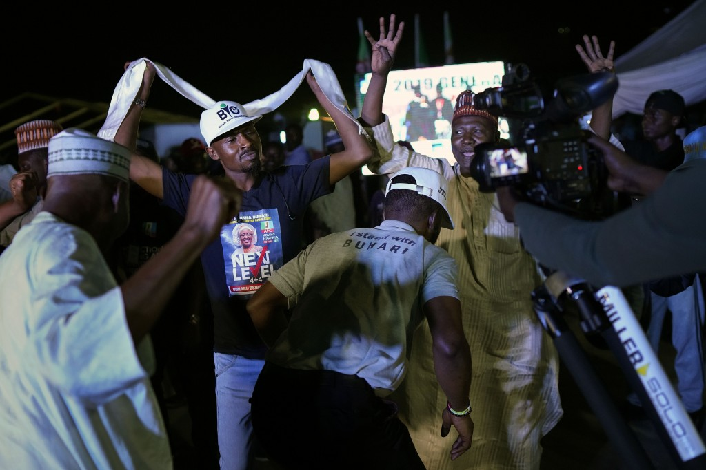 Supporters of Incumbent President Muhammadu Buhari party anticipating a win as they wait for the results to be officially announced in Abuja, Nigeria,...