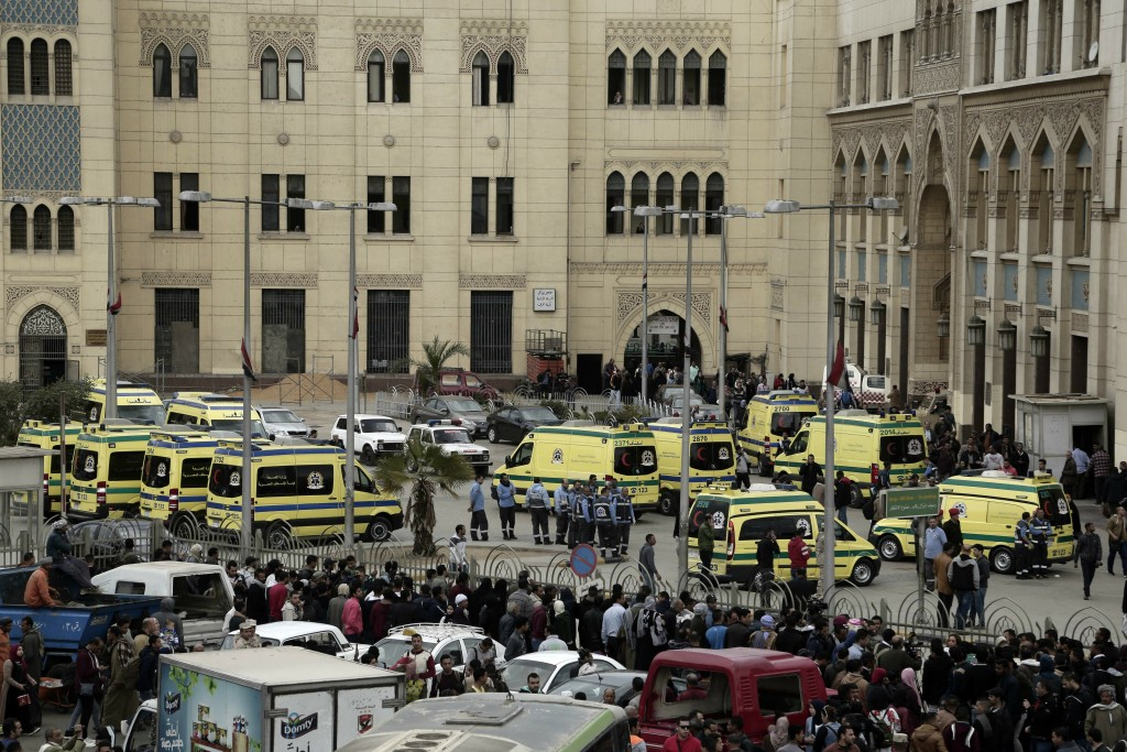 Ambulances are parked outside Ramsis train station after a train crash in Cairo, Egypt, Wednesday, Feb. 27, 2019. An Egyptian medical official said at