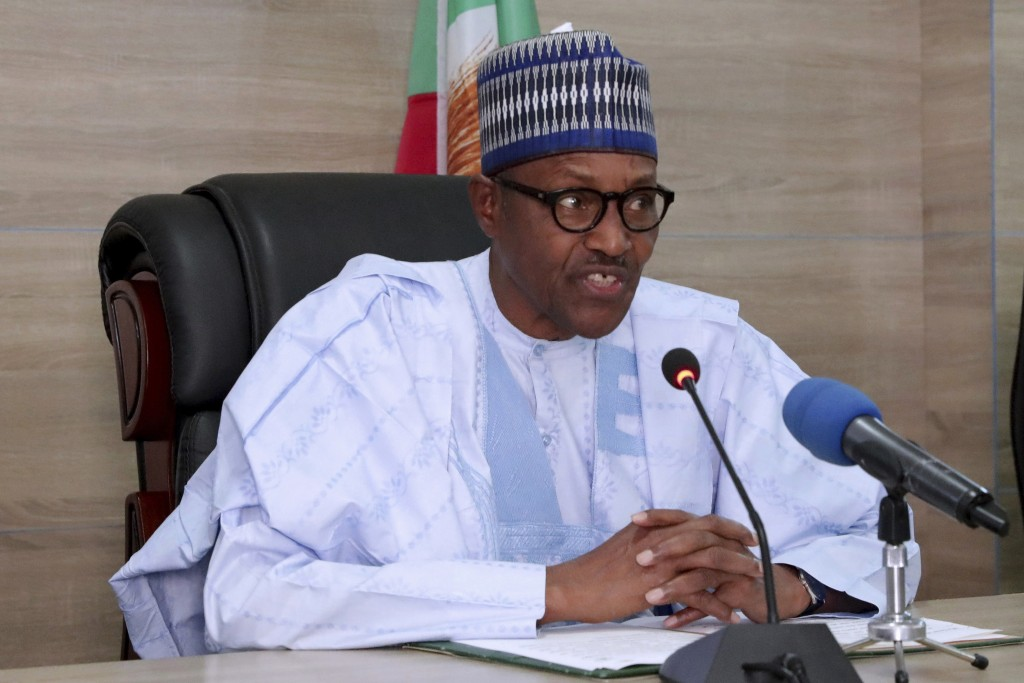In this photo released by the Nigeria State House, Nigeria's incumbent President Muhammadu Buhari, of the All Progressives Congress party, speaks as h...