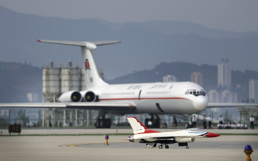 FILE - In this Sept. 25, 2016, file photo, a remote-controlled F-16 fighter jet lands in front of an Air Koryo commercial airplane at the Kalma Airpor...