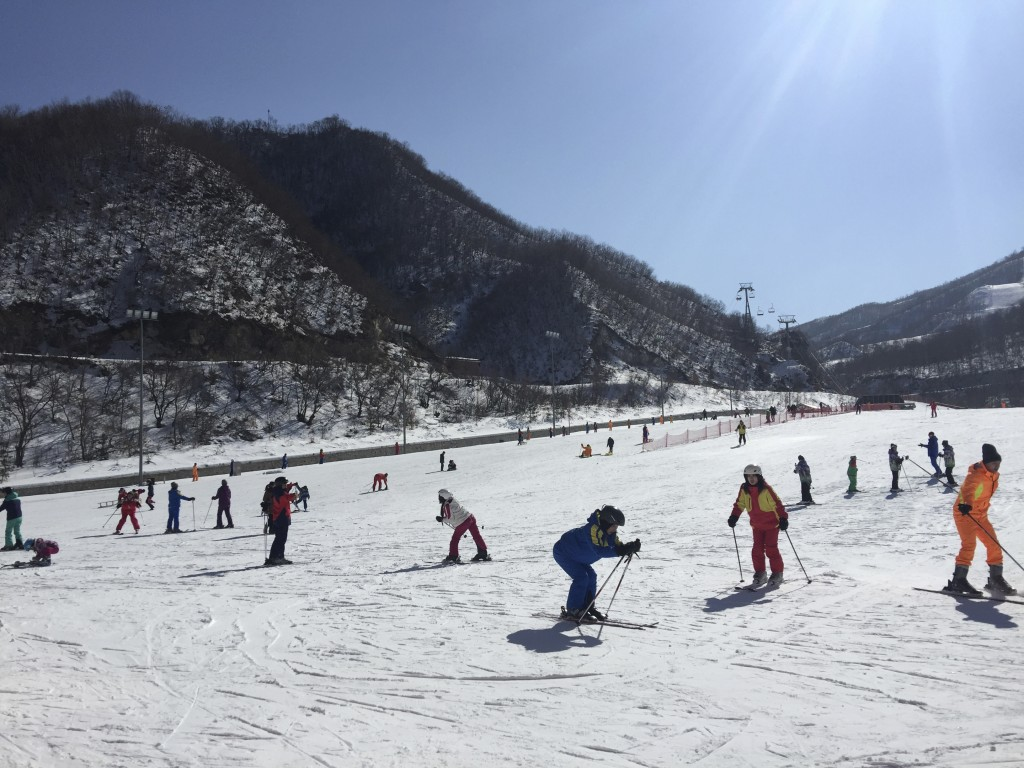 FILE - In this Feb. 11, 2017, photo, North Koreans ski at the Masik Pass Ski Resort in Wonsan, North Korea. With U.S. President Donald Trump and North