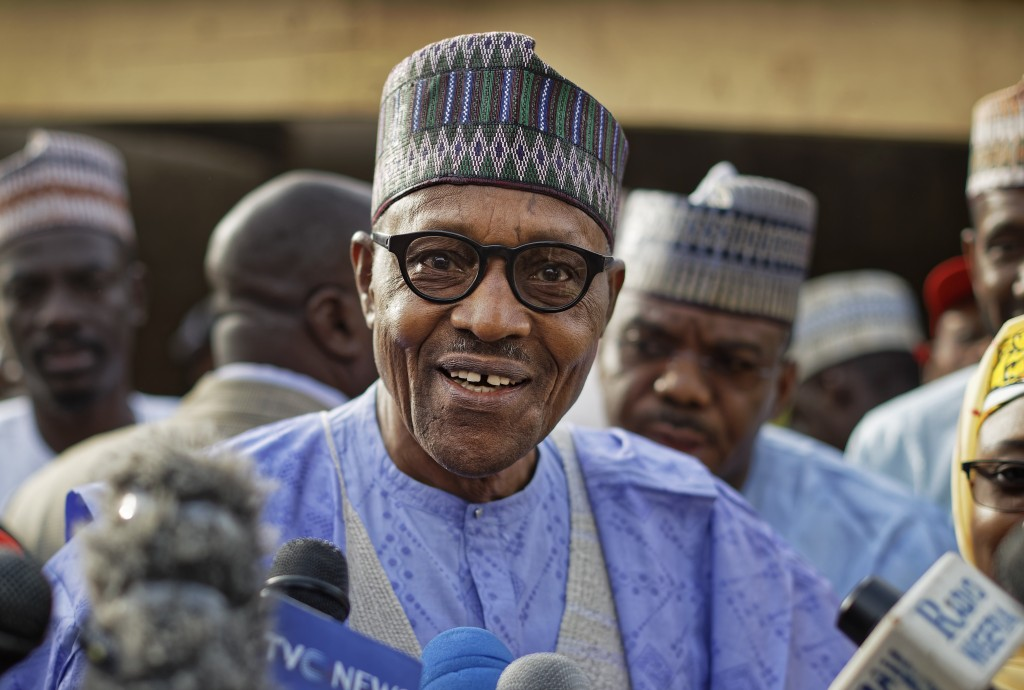 FILE - In this Saturday, Feb. 23, 2019 file photo, Nigeria's President Muhammadu Buhari speaks to the media after casting his vote in his hometown of ...