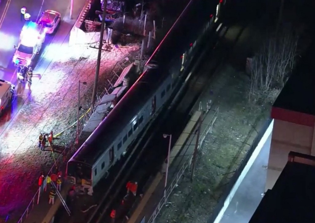 Commuter delays after crash of vehicle, 2 trains