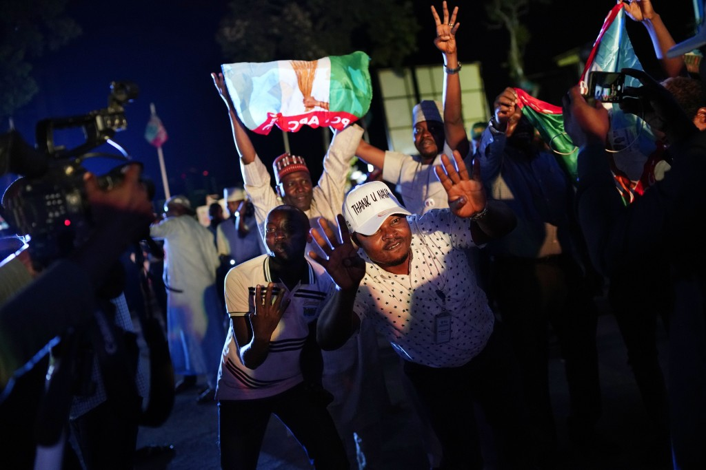 Supporters of Incumbent President Muhammadu Buhari dance to Lady Gaga songs anticipating a win as they wait for the results to be officially announced...