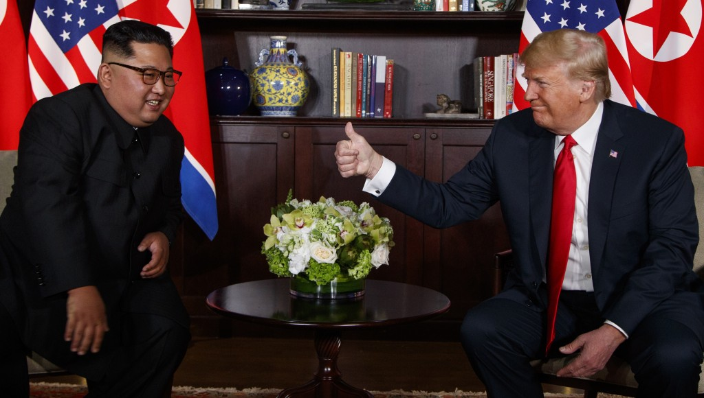 FILE - In this June 12, 2018, file photo, U.S. President Donald Trump, right, meets with North Korean leader Kim Jong Un on Sentosa Island, in Singapo