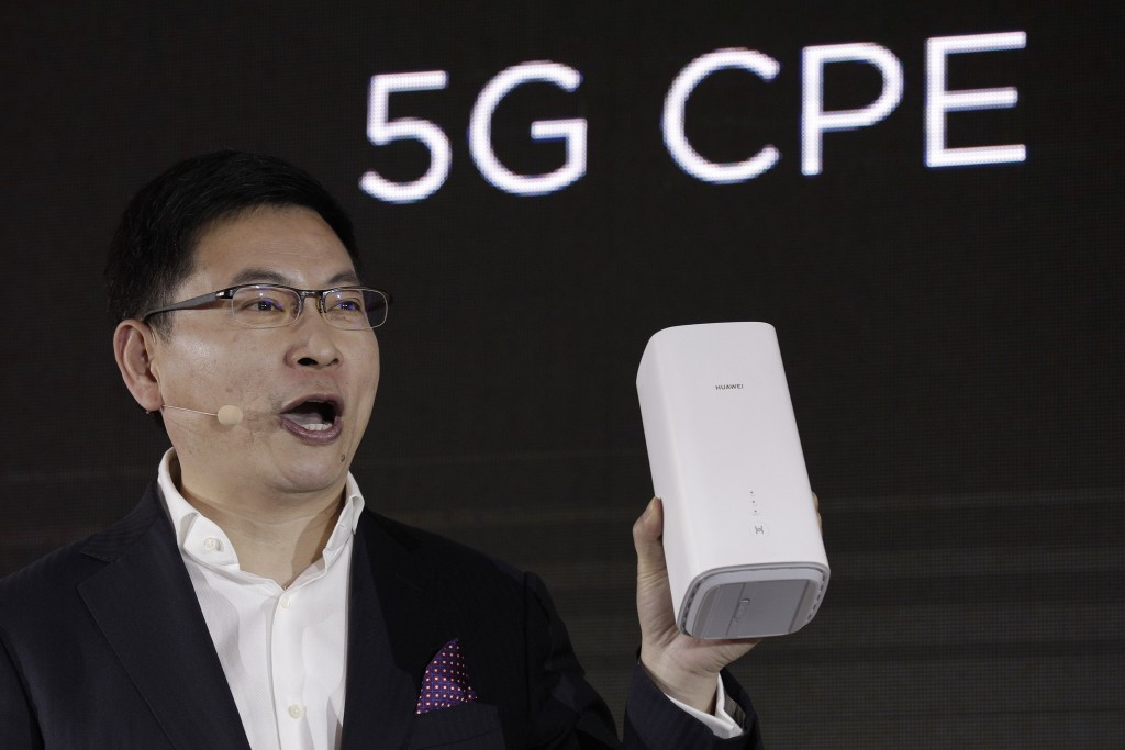 FILE - In this Jan. 24, 2019, file photo Richard Yu, CEO of the Huawei consumer business group speaks as he unveils the wireless router running with 5