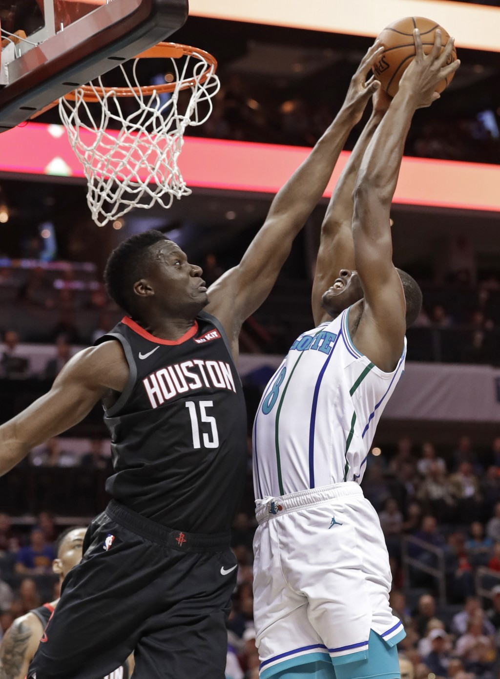 Houston Rockets' Clint Capela (15) blocks a shot by Charlotte Hornets' Bismack Biyombo (8) during the first half of an NBA basketball game in Charlott