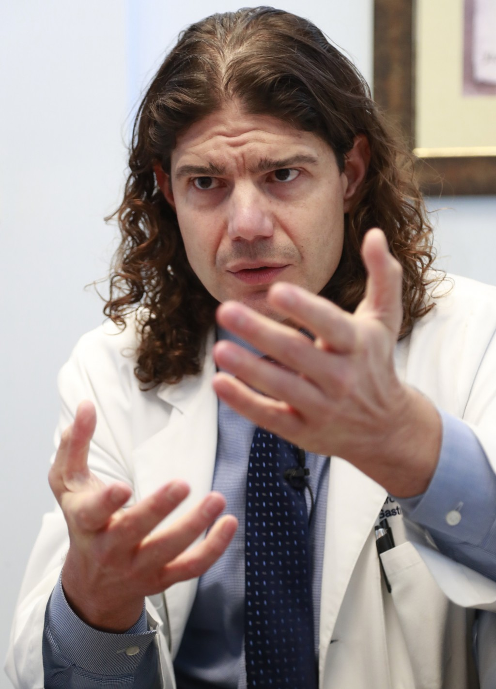 In this Feb. 15, 2019 photo, Venezuelan Pedro Morales, a gastroenterologist who has lived in Miami for over two decades, speaks during an interview in