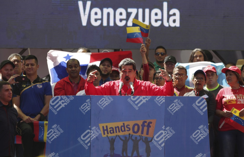 FILE - In this Feb. 23, 2019 file photo, Venezuela's President Nicolas Maduro speaks to supporters during a pro-government rally in Caracas, Venezuela