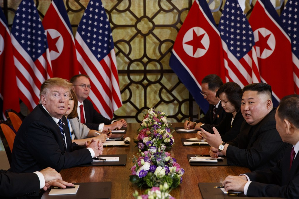President Donald Trump listens as North Korean leader Kim Jong Un answers a question from reporters during a meeting, Thursday, Feb. 28, 2019, in Hano...