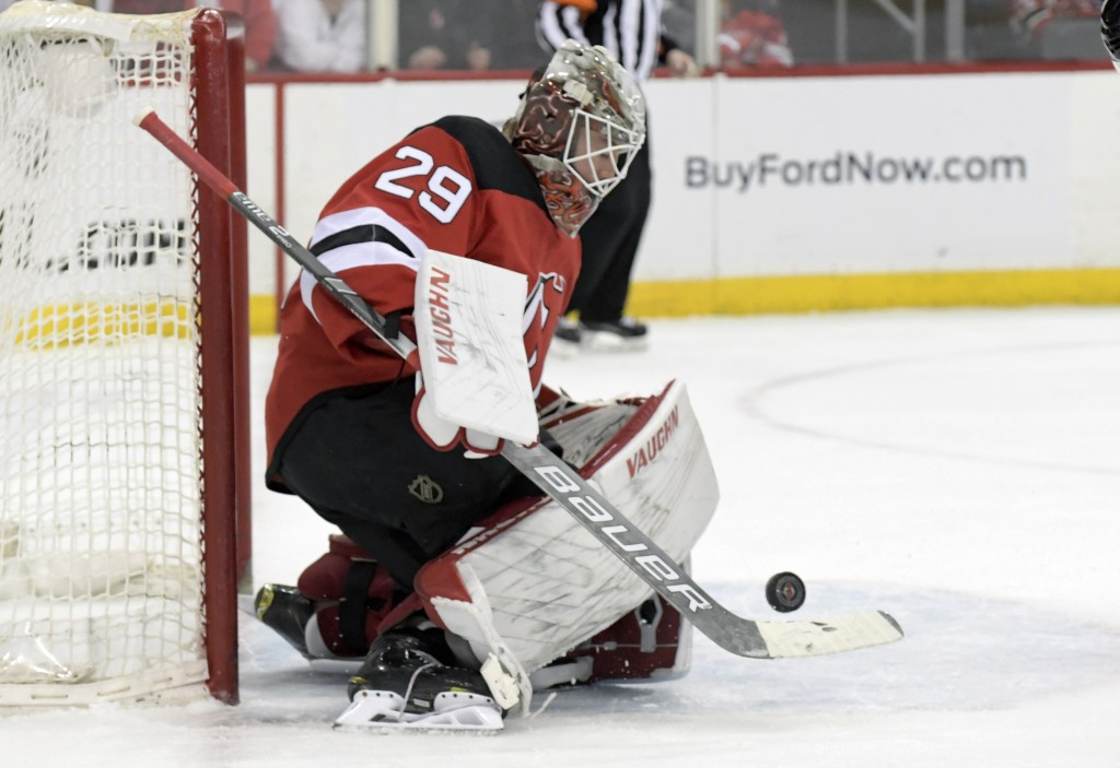 e61894a27 New Jersey Devils goaltender Mackenzie Blackwood (29) deflects the puck  during the first period