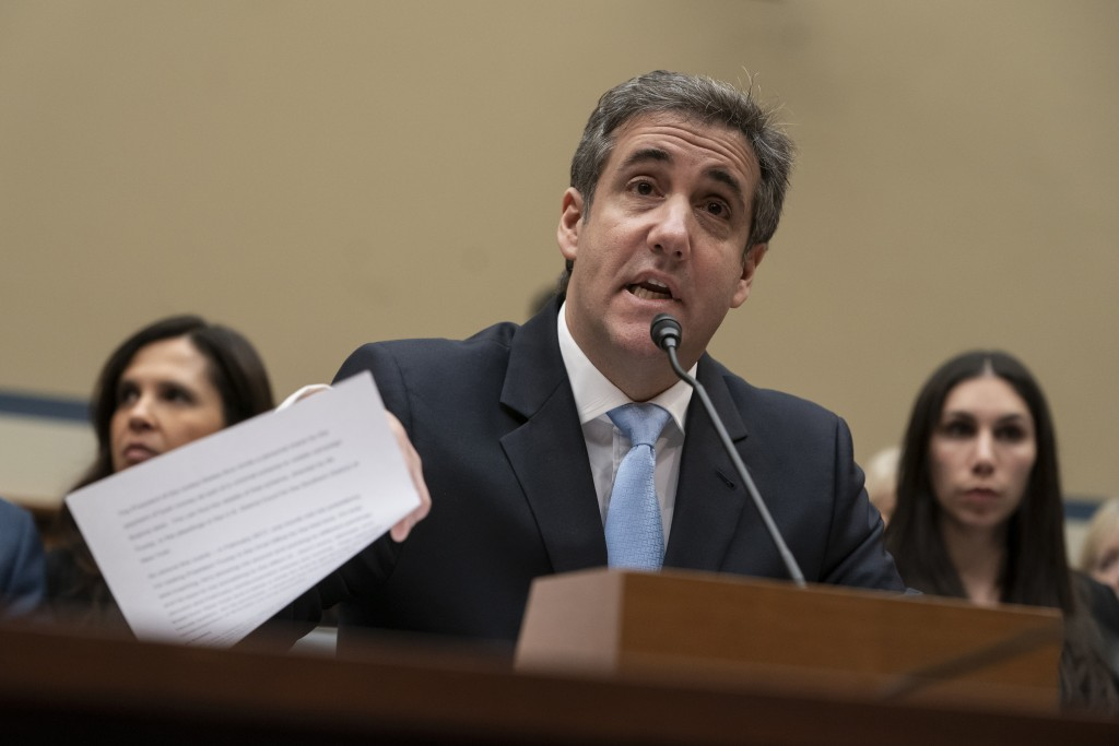 FILE - In this Wednesday, Feb. 27, 2019 file photo, Michael Cohen, President Donald Trump's former personal lawyer, reads an opening statement as he t...