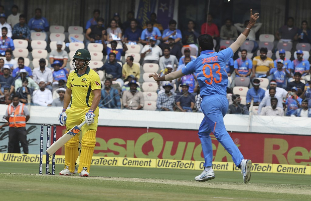 India's bowler Jasprit Bumrah celebrates the wicket of Australia's Aaron Finch during the first one-day international cricket match between India and ...