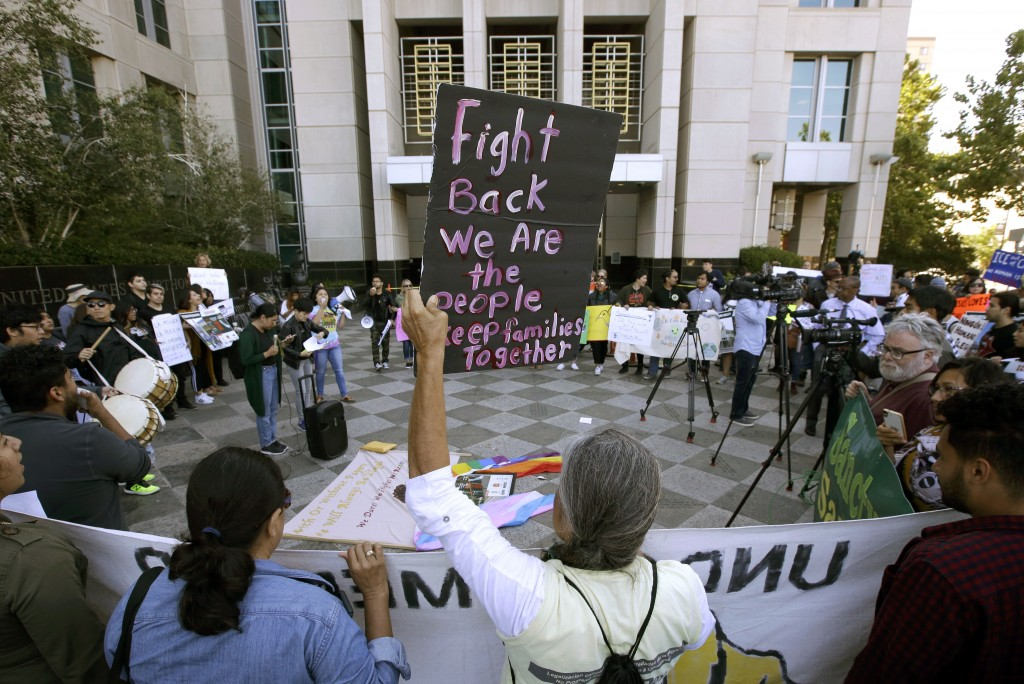FILE - In this June 20, 2018, file photo, protesters demonstrate outside the federal courthouse in Sacramento, Calif., where a judge heard arguments o