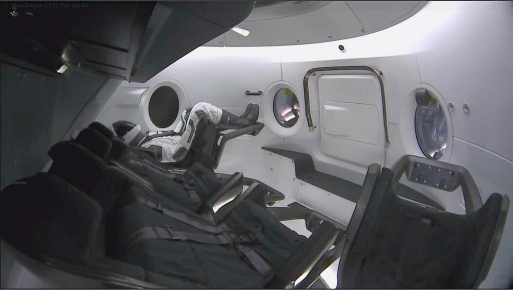 This photo provided by SpaceX shows a test dummy in the new Dragon capsule designed for astronauts.  A six-day test flight will be real in every regar