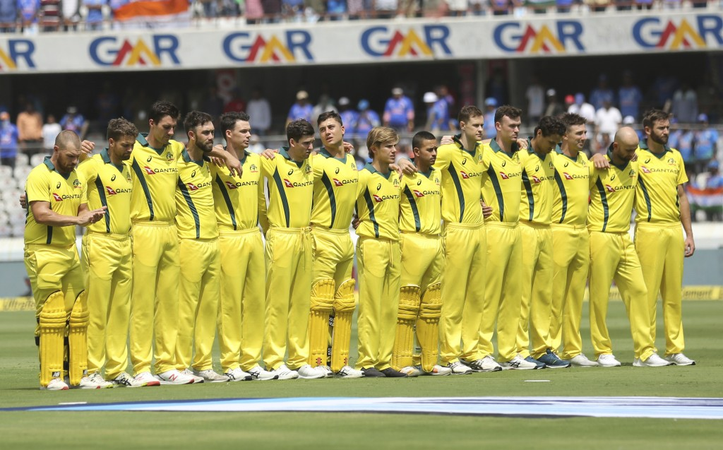 Australia's captain Aaron Finch, left, and teammates stand for the national anthem before the first one-day international cricket match between India ...