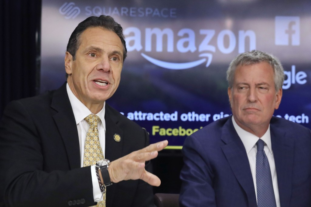 FILE - In this Nov. 13, 2018, file photo, New York Gov. Andrew Cuomo, left, and New York City Mayor Bill de Blasio hold a news conference in New York.